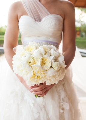 Bride holding ivory garden roses and peonies wedding flowers