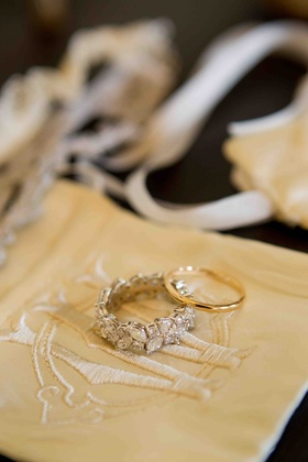 Gold men's band and marquise-cut diamonds on wedding ring