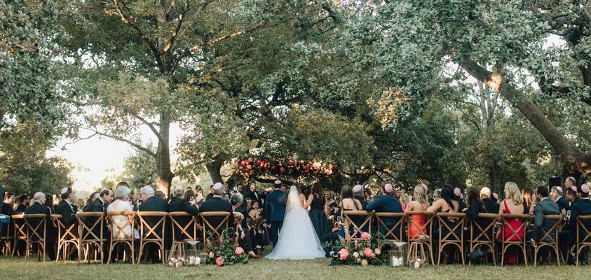 outdoor wedding ceremony diamond affairs weddings wood vineyard chairs greenery trees pink flowers