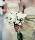 Bridesmaid flowers in white and tied with sheer fabric
