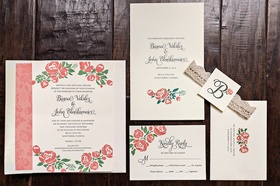 Wedding invitation suite with pink flower and vine motif