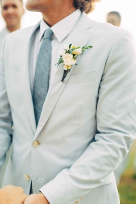 green ivory boutonniere gray blue suit groom beach destination wedding mexico ceremony punta mita
