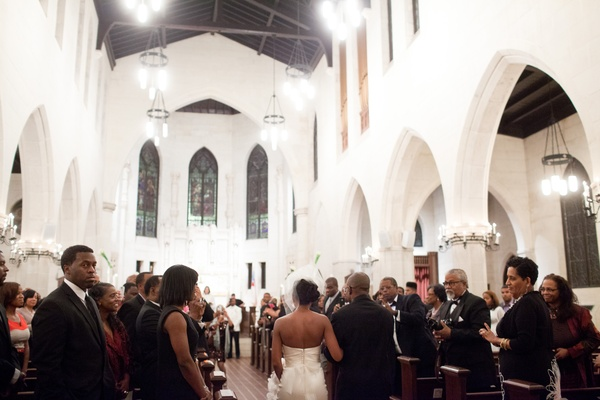 Guests rose while bride walked down aisle of church