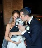 bride in strapless wedding dress flower applique groom in tuxedo with yarmulke little dog in tuxedo