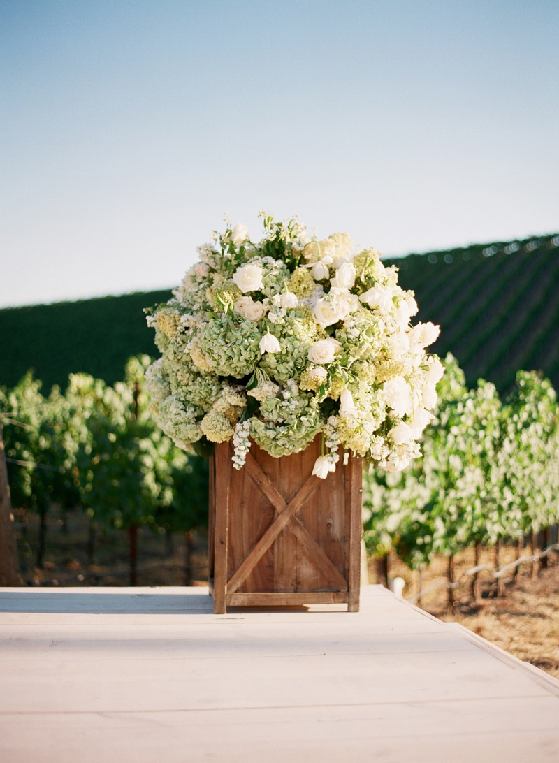 Wood box filled with white and green flowers
