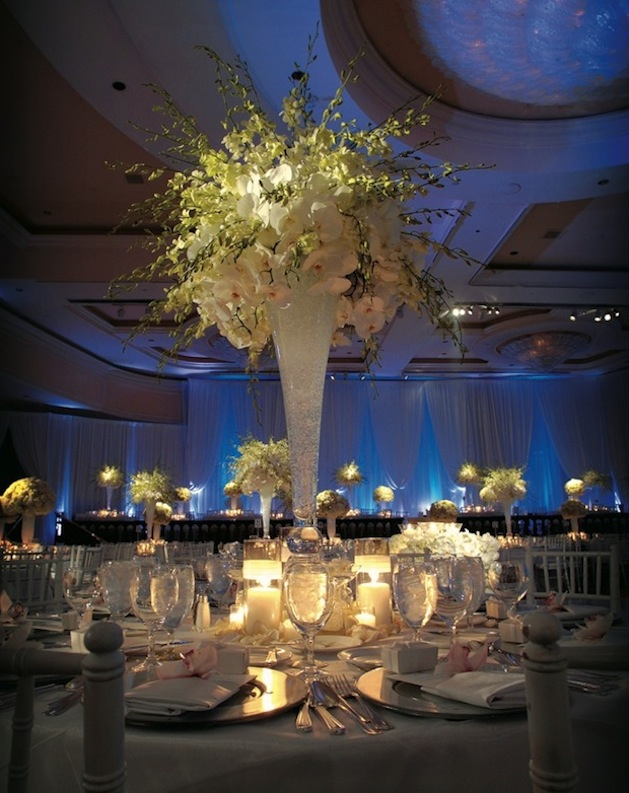 Tall wedding centerpieces wedding flowers inside weddings the dramatic look we love in wedding flowers towering centerpieces junglespirit Image collections