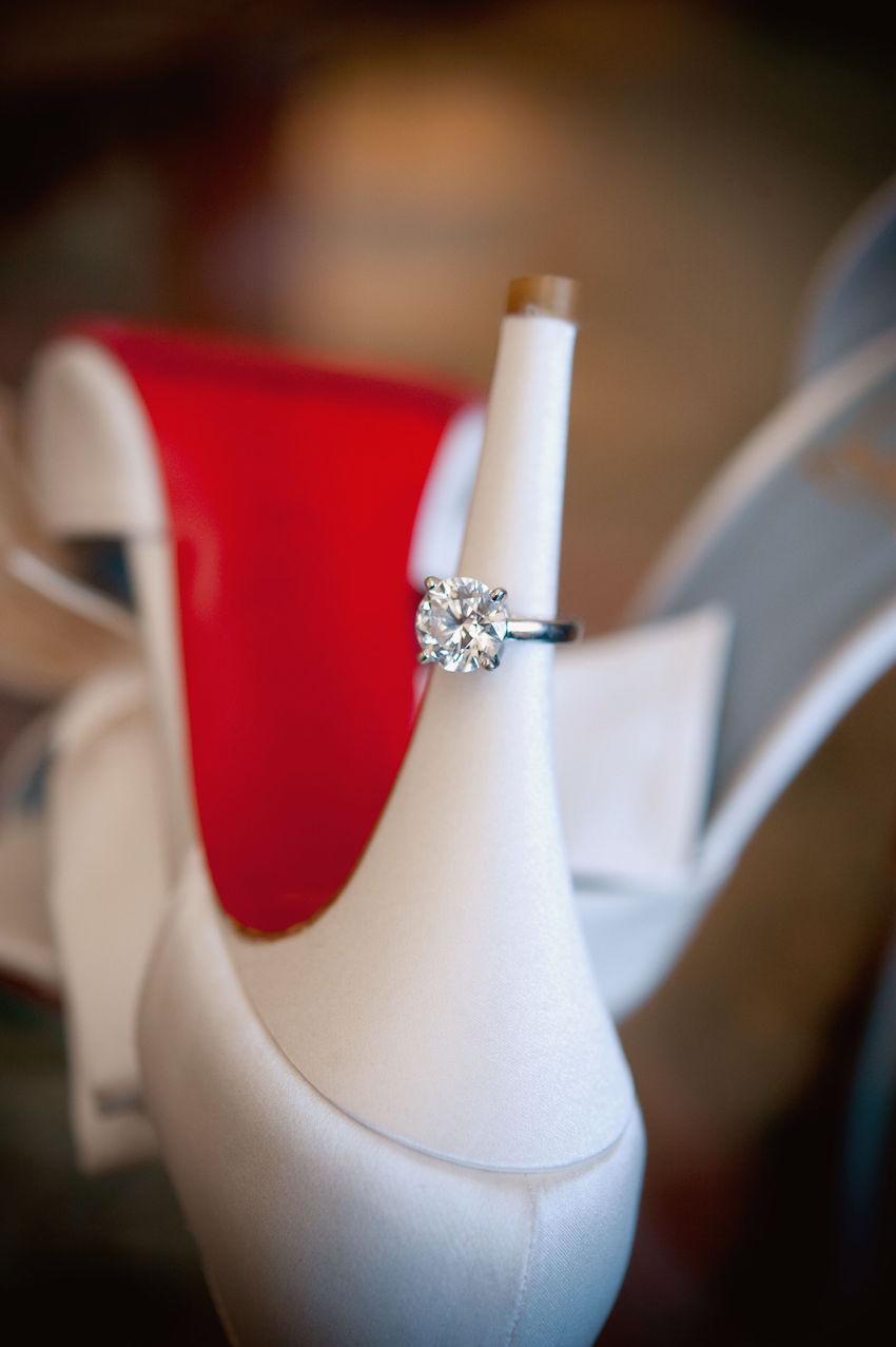 Round diamond engagement ring on Christian Louboutin shoe