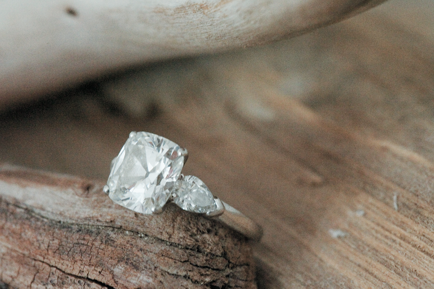 Diamond on wood background with side stones