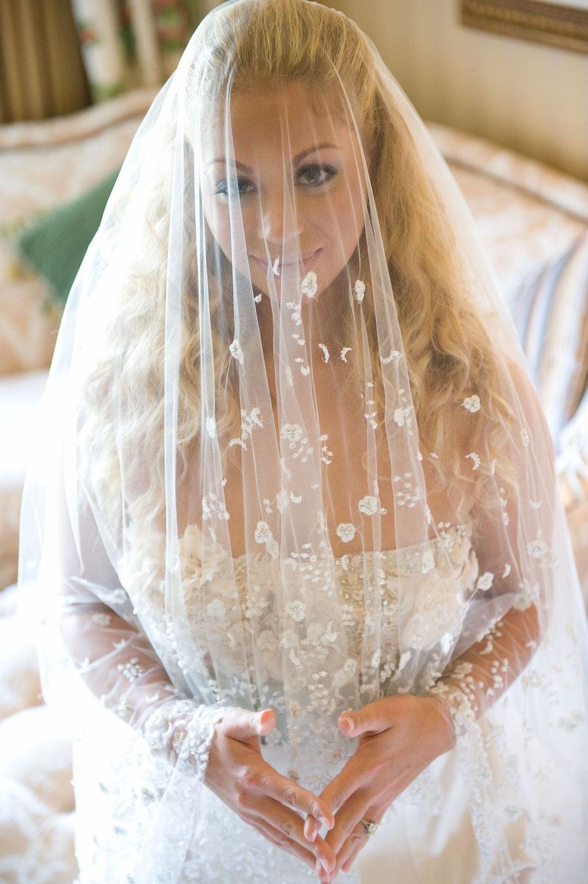 Flower print wedding veil on bride