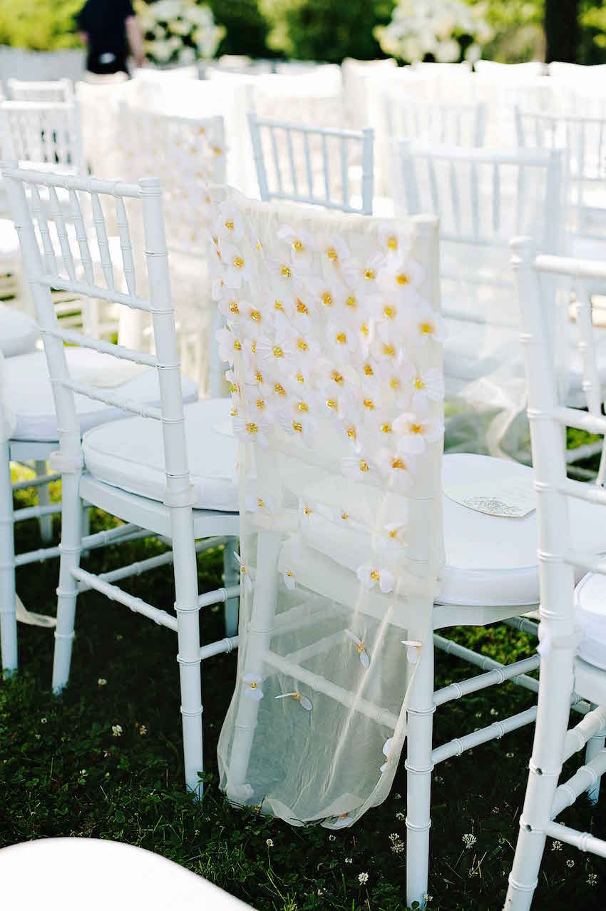 Daisy flower print chair cover at wedding ceremony