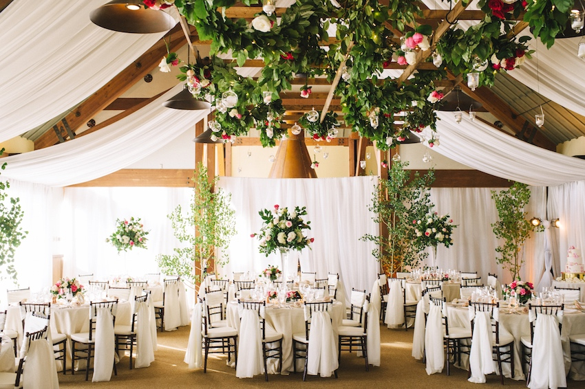 White rustic reception with drapes