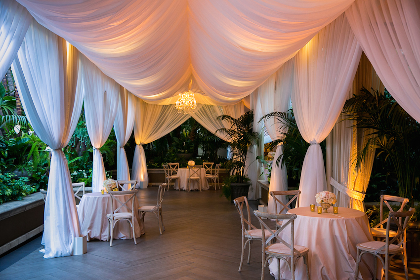 Pink drapes at outdoor patio cocktail hour & Wedding Drapes: How to Add Romance to Your Event - Inside Weddings