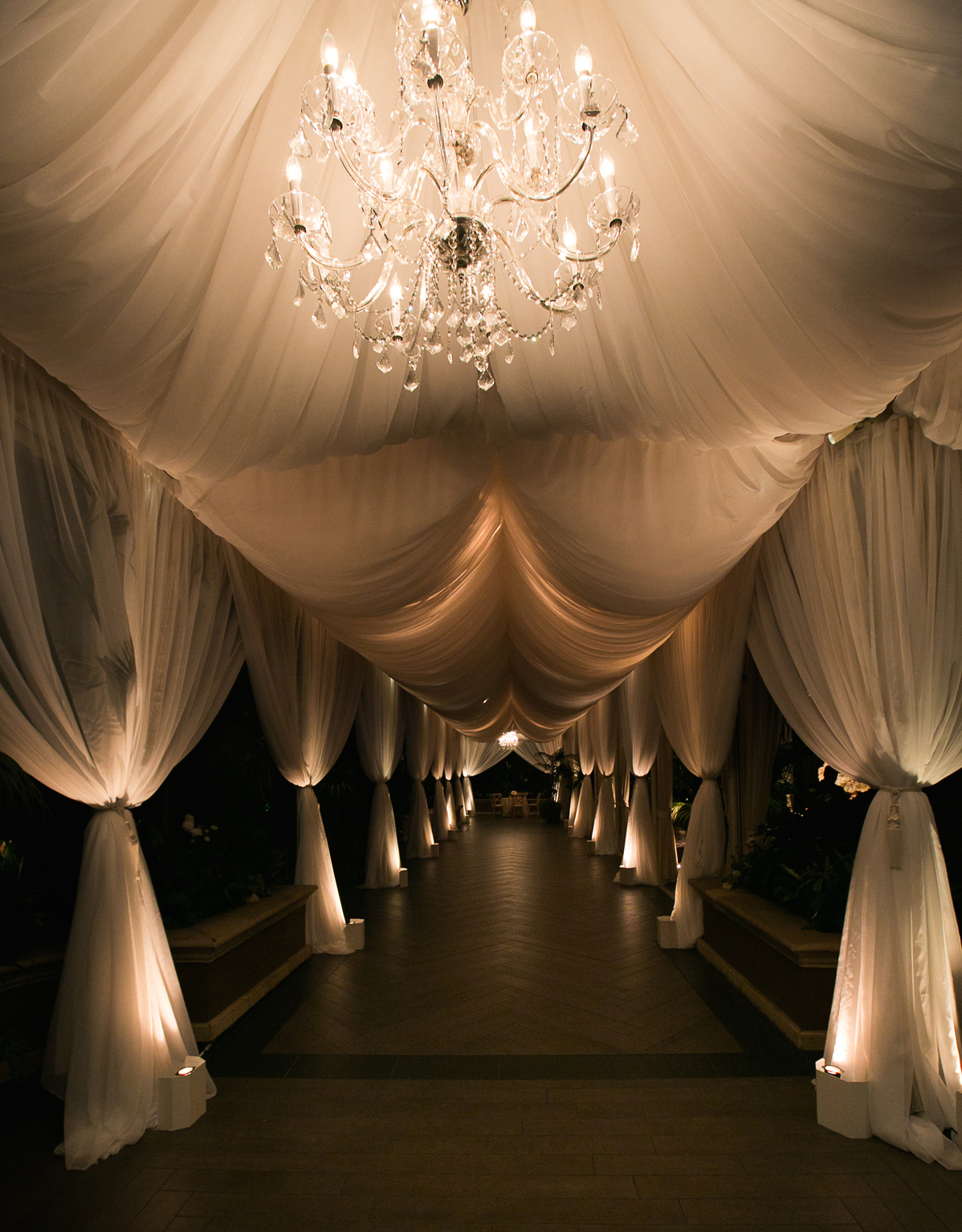 Dark Exit through drapes at wedding