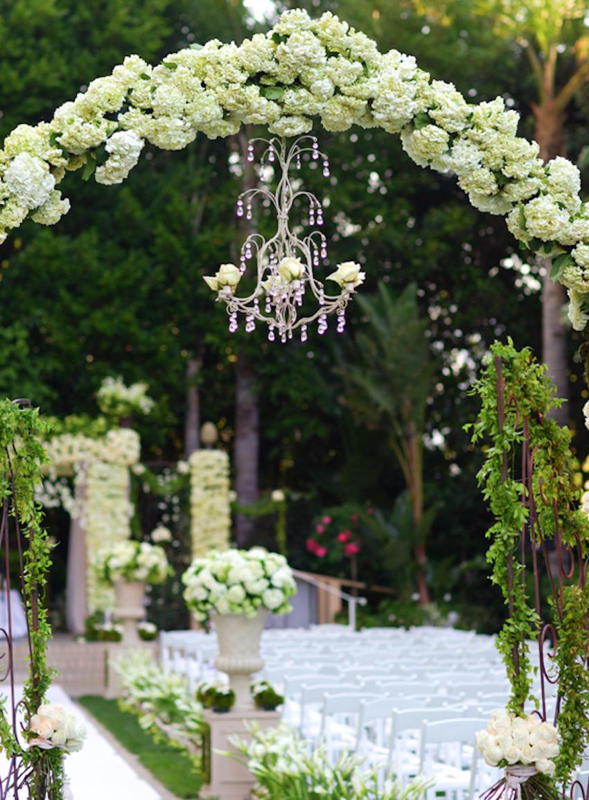 Chandelier Under Flower Arch At Ceremony