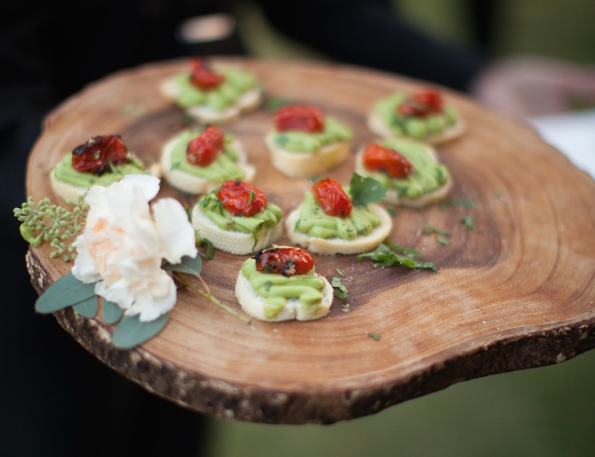 Hors d'oeuvres on rustic wood slab