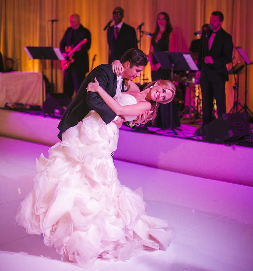 Pink lighting for bride and groom first dance