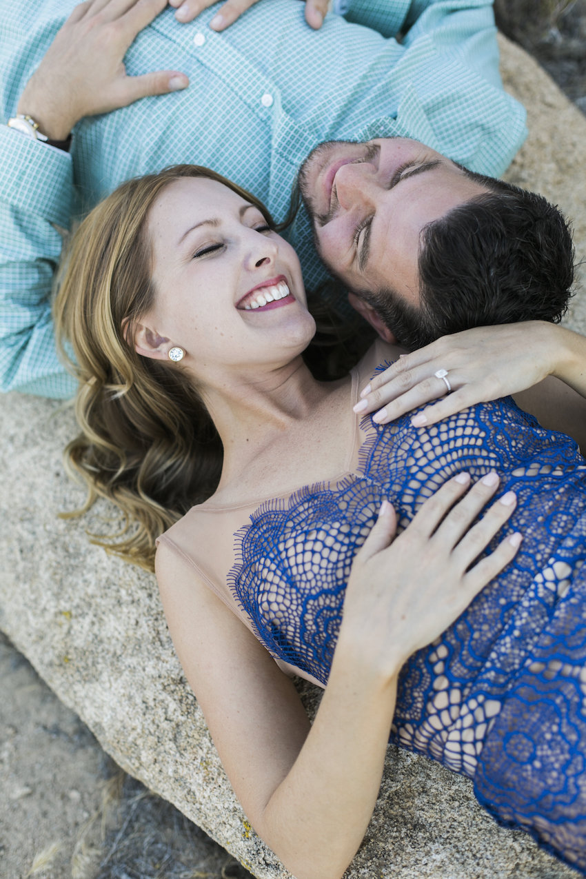 Laughing on desert rock engagement session