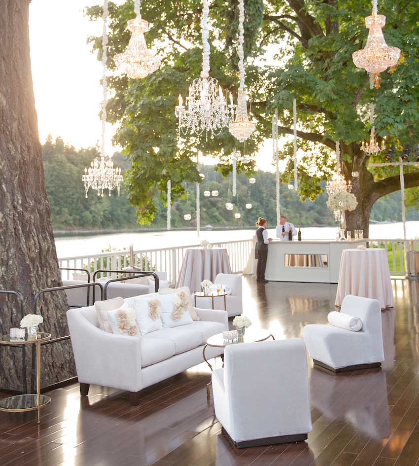 Chandeliers over outdoor wood lounge area