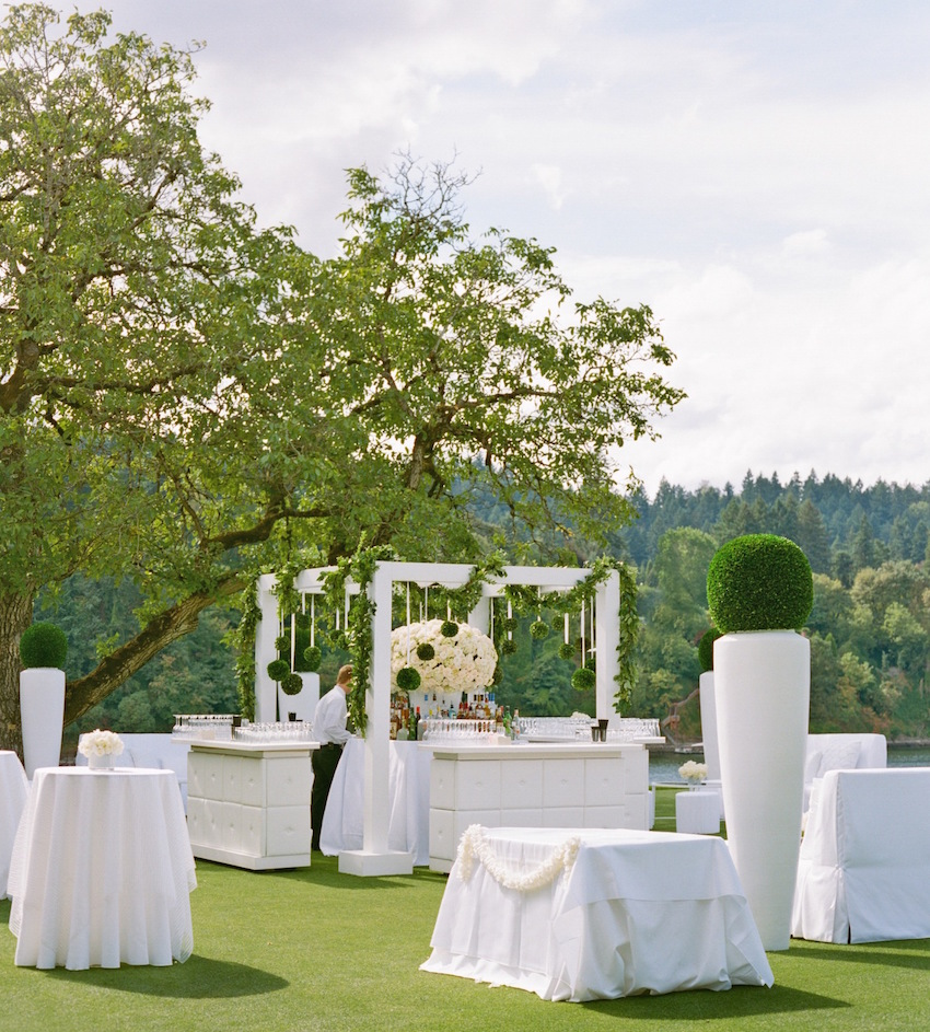 Outdoor wedding bar on grass lawn
