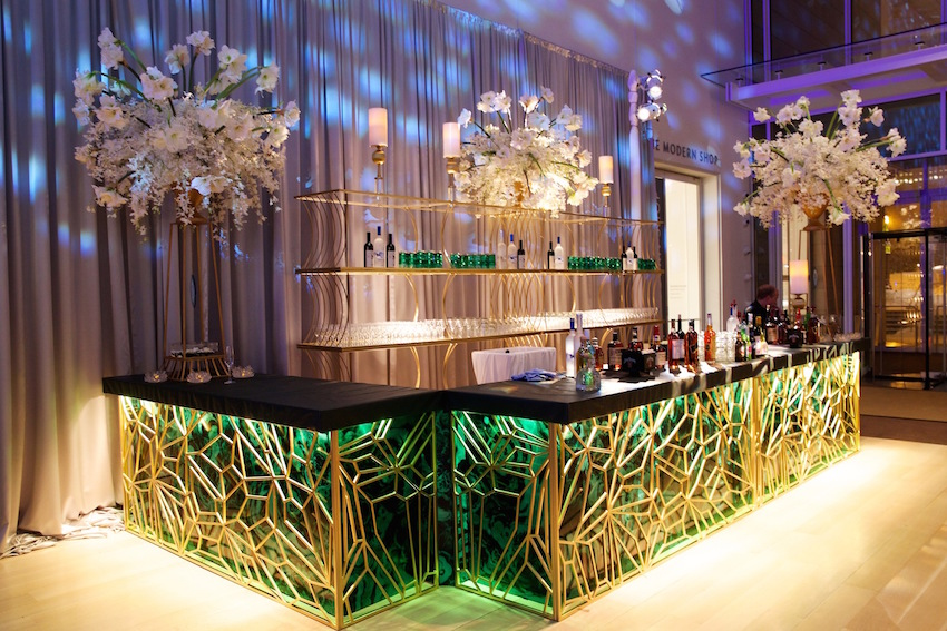 Green and gold wedding bar at reception