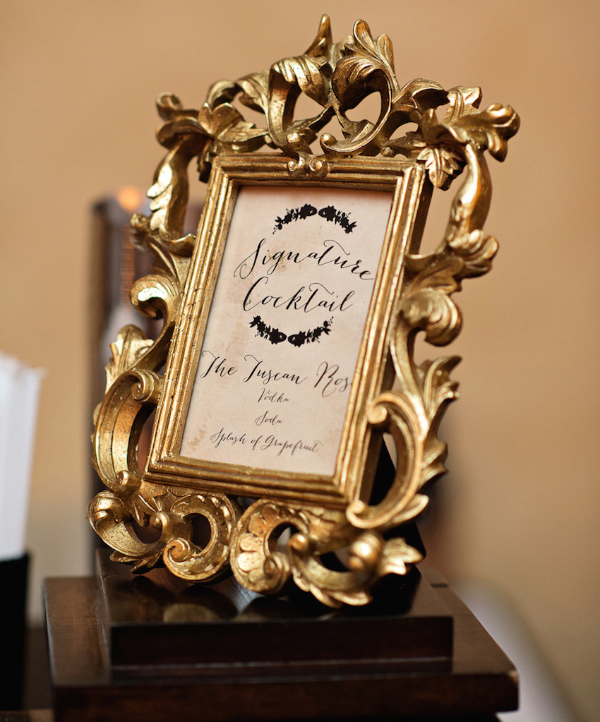 Gold baroque frame with signature cocktail menu