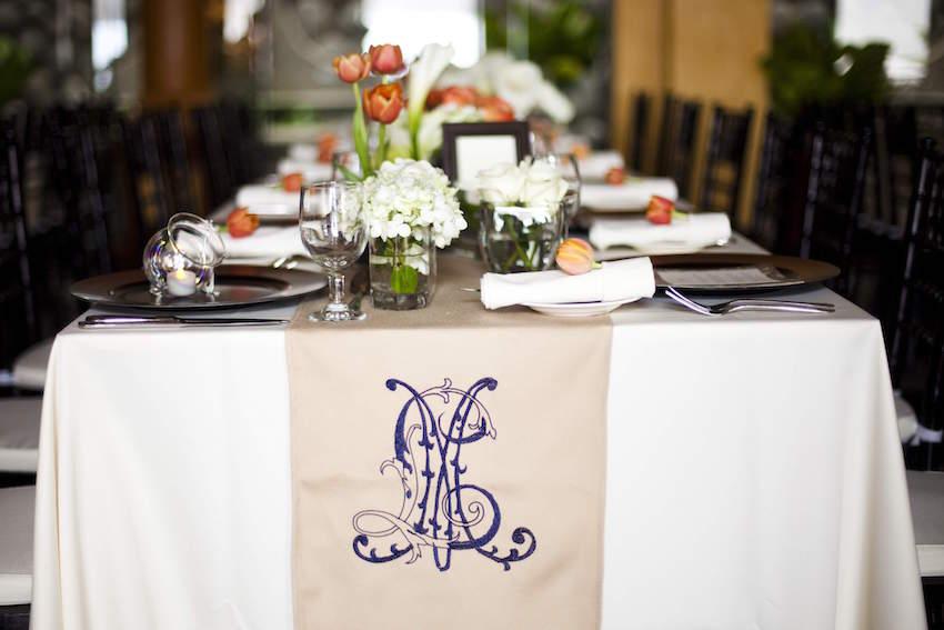 Monogram linen table runner at wedding