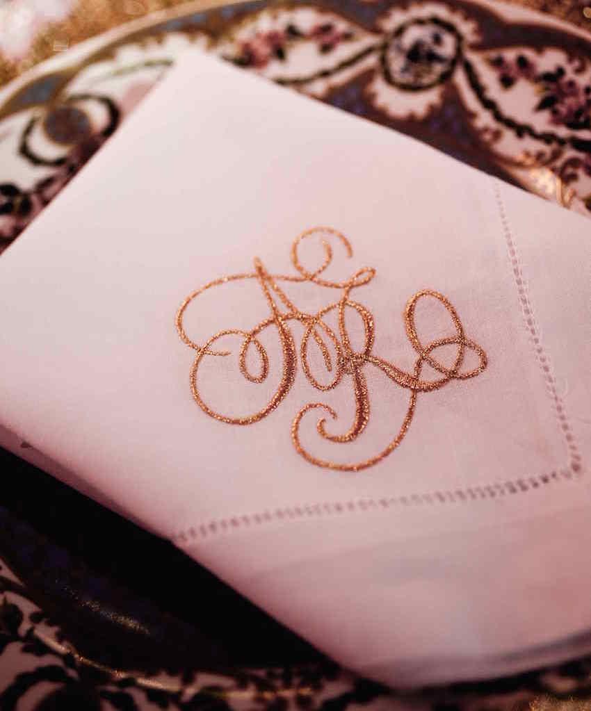 Gold monogram embroidered linen dinner napkin