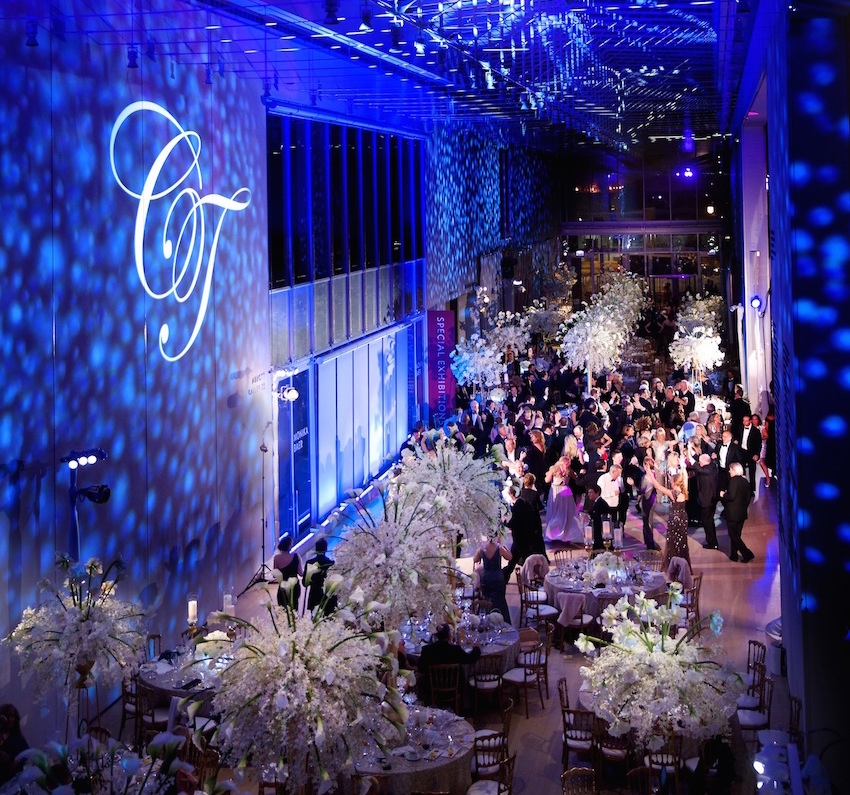 Blue monogram gobo lighting on wall at reception