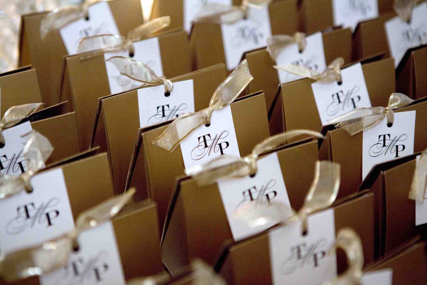 Gold and white monogram wedding favors