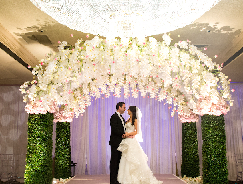 Bride and groom under Jewish chuppah