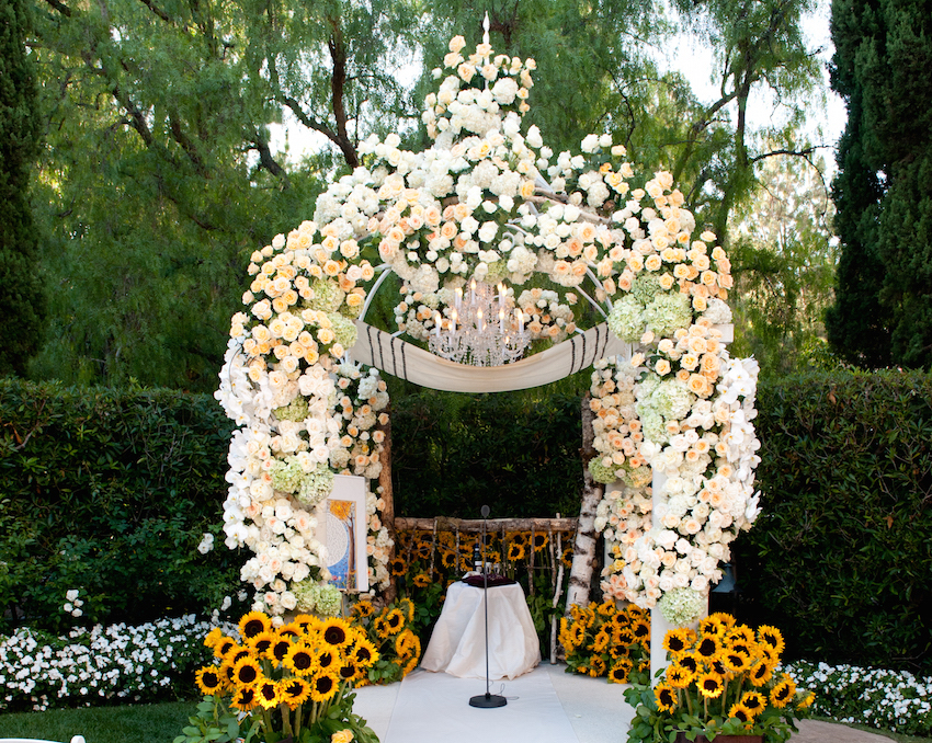 Sunflower chuppah with tallit as roof