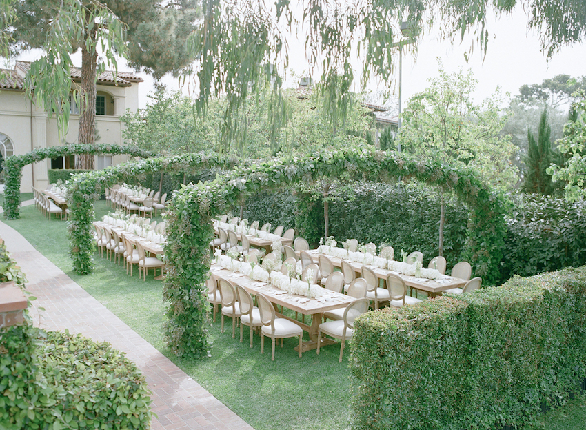 Neutral outdoor wedding ideas with green arches