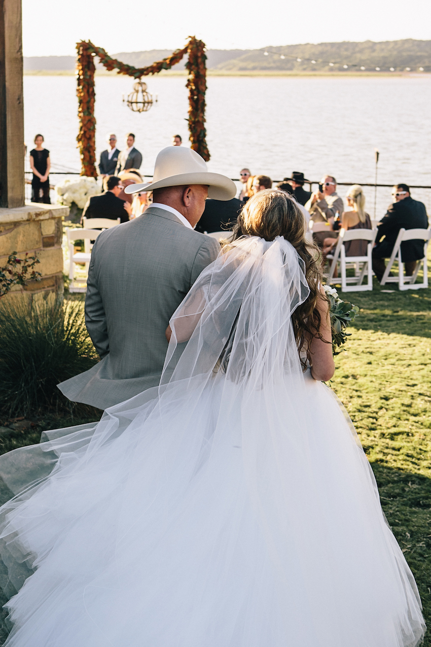 Bride With Cowboy Father Of Walking Down Aisle