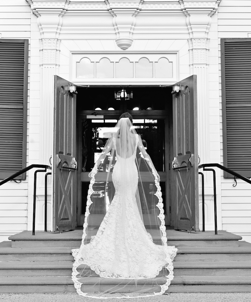 Black And White Photo Of Bride In Front Church