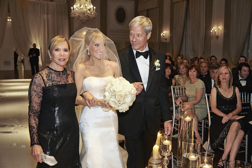 Bride Walks Down Aisle With Parents At Wedding Processional Songs