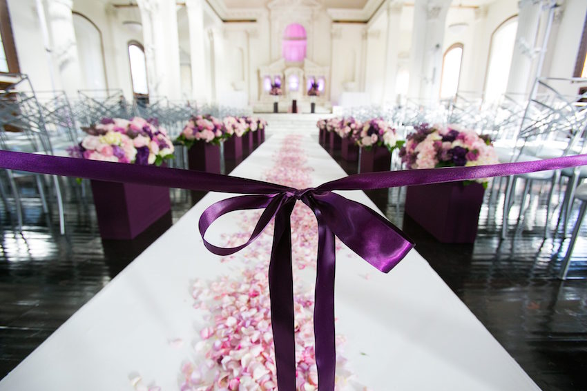 Purple wedding ceremony with ribbon & Wedding Color Palettes: Purple Décor - Inside Weddings