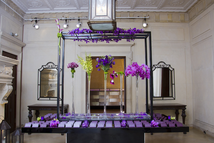 Purple flowers on escort card display