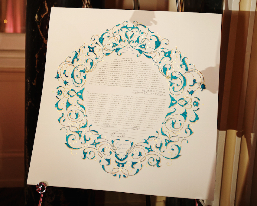 blue and gold ketubah at wedding
