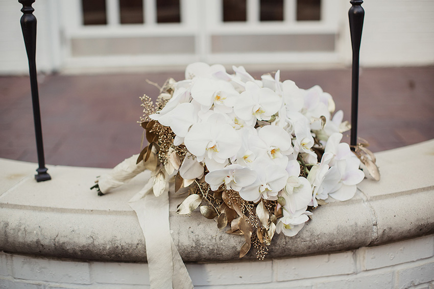 Fall flower bouquets for festive autumn weddings inside weddings white orchid bouquet with gold leaves fall flower mightylinksfo