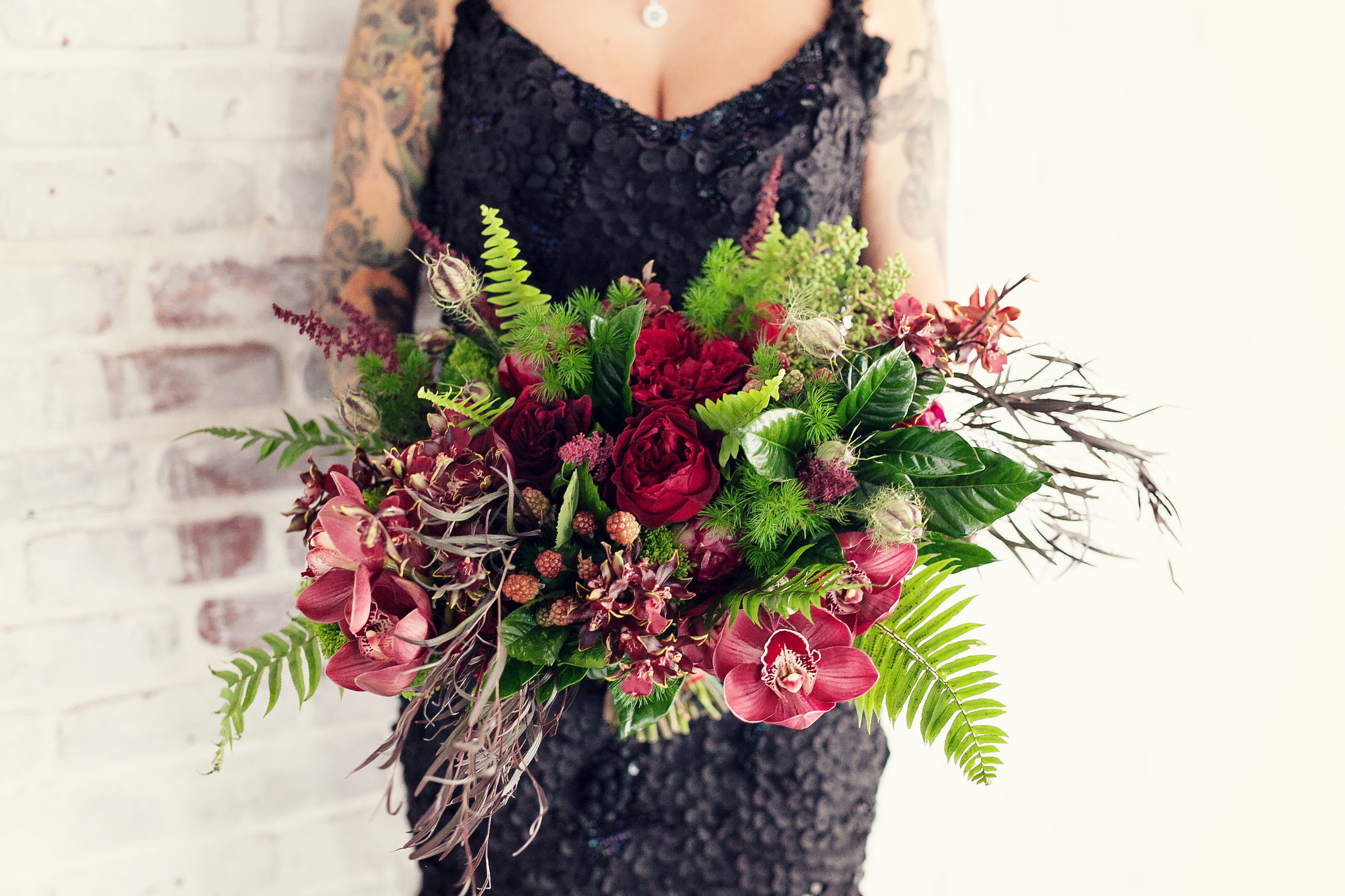 Halloween weddings 17 ways to bring gothic style to your wedding red flowers and greenery izmirmasajfo Choice Image
