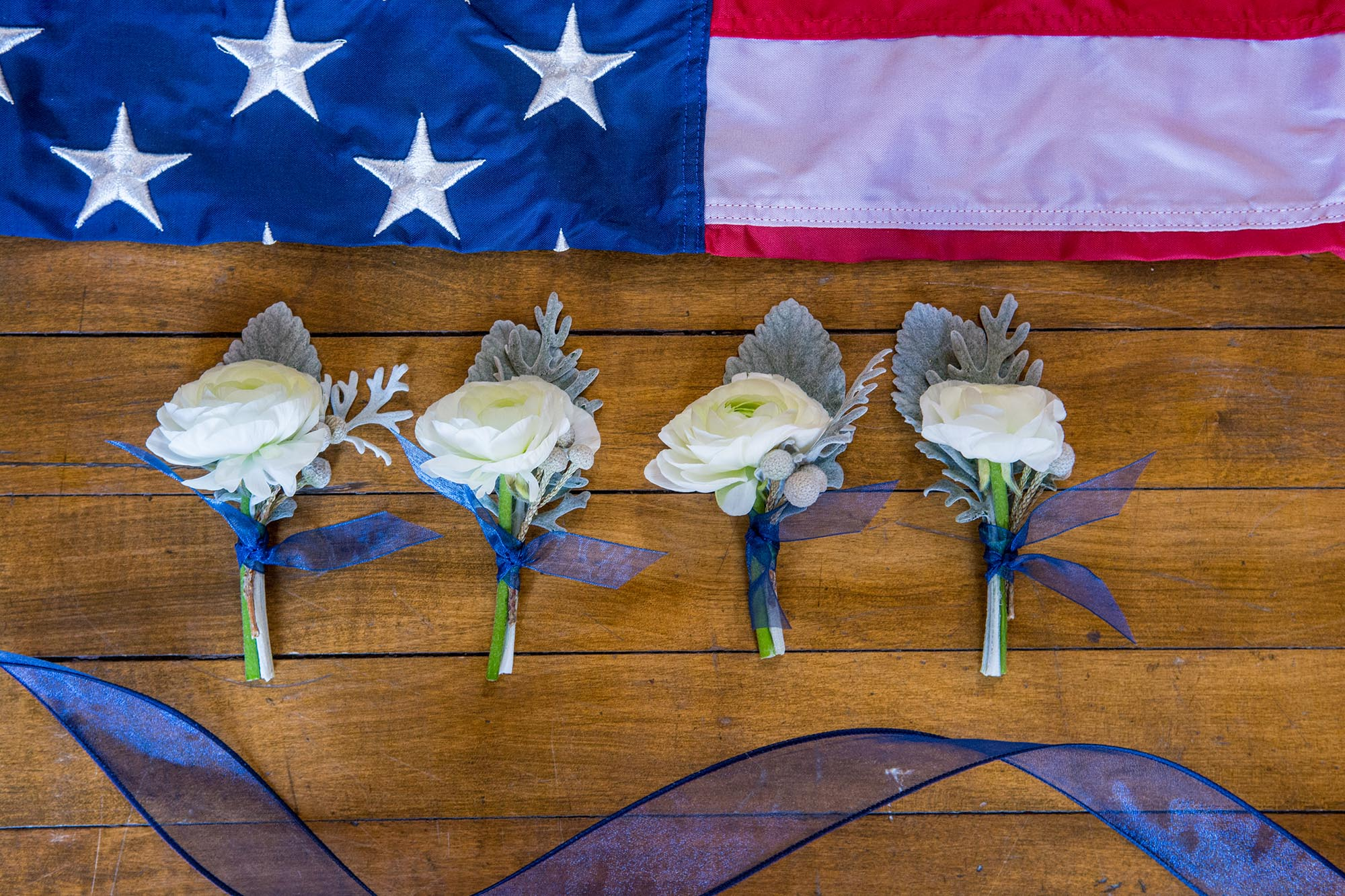 white and blue boutonnieres