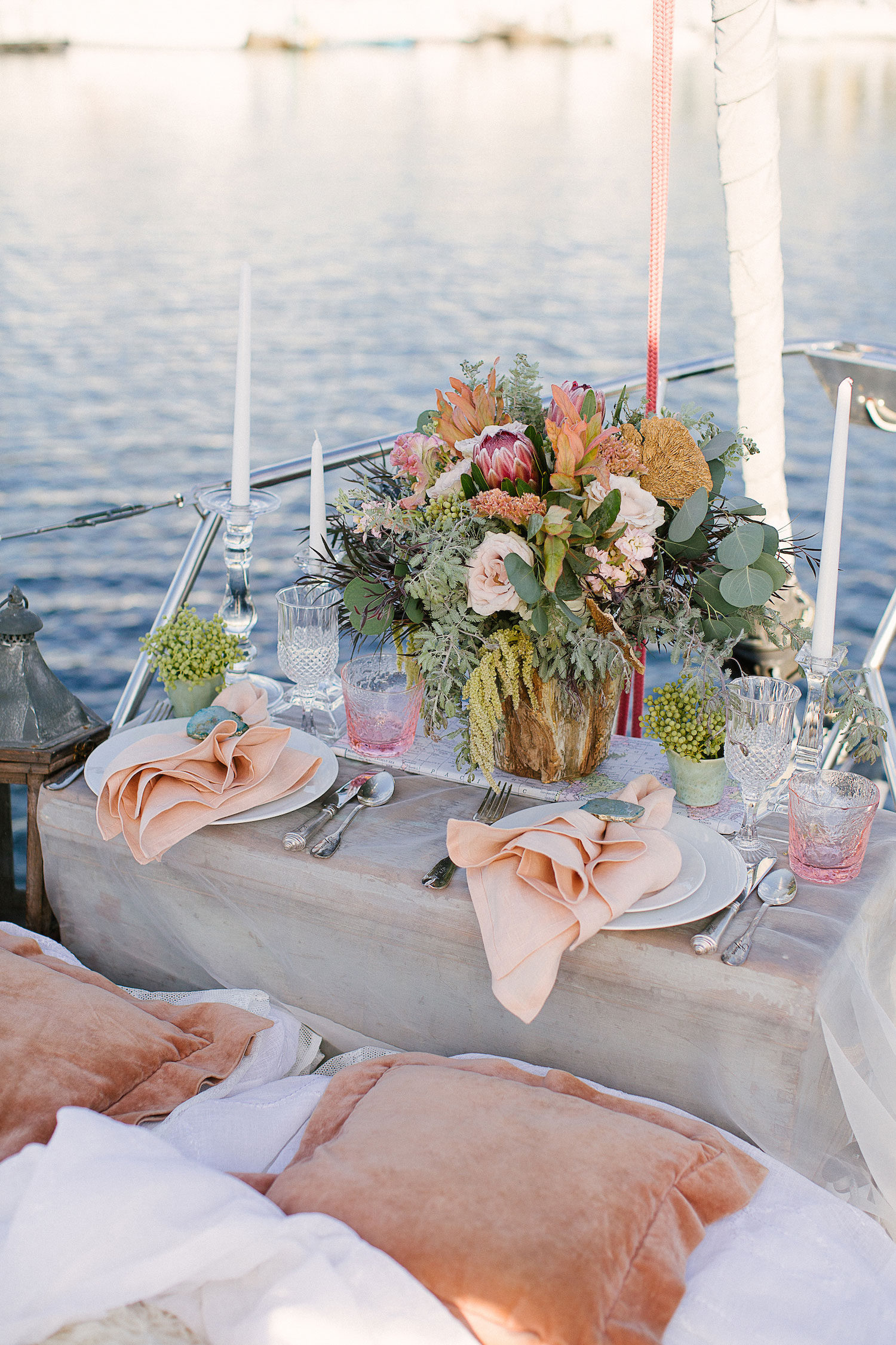 Private dinner set up on bow of sailboat