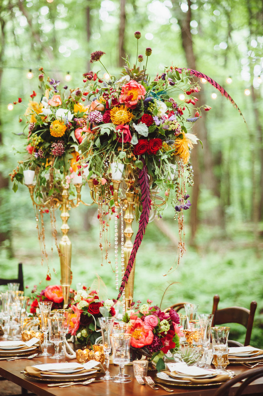 Fall wedding centerpiece with feathers