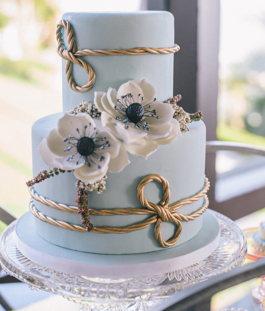 Blue small wedding cake with gold rope