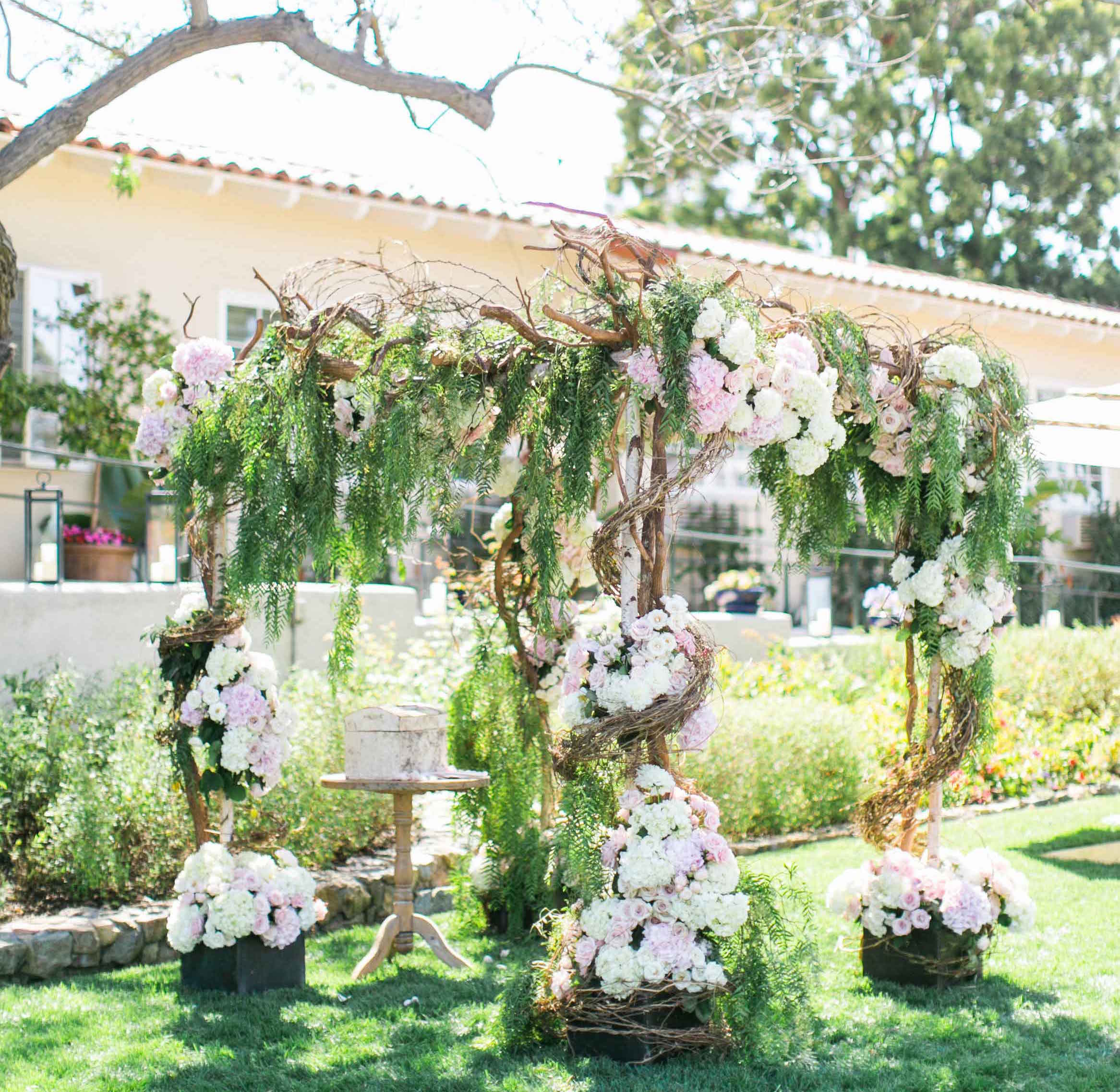 wedding ceremony ideas flower covered wedding arch inside weddings