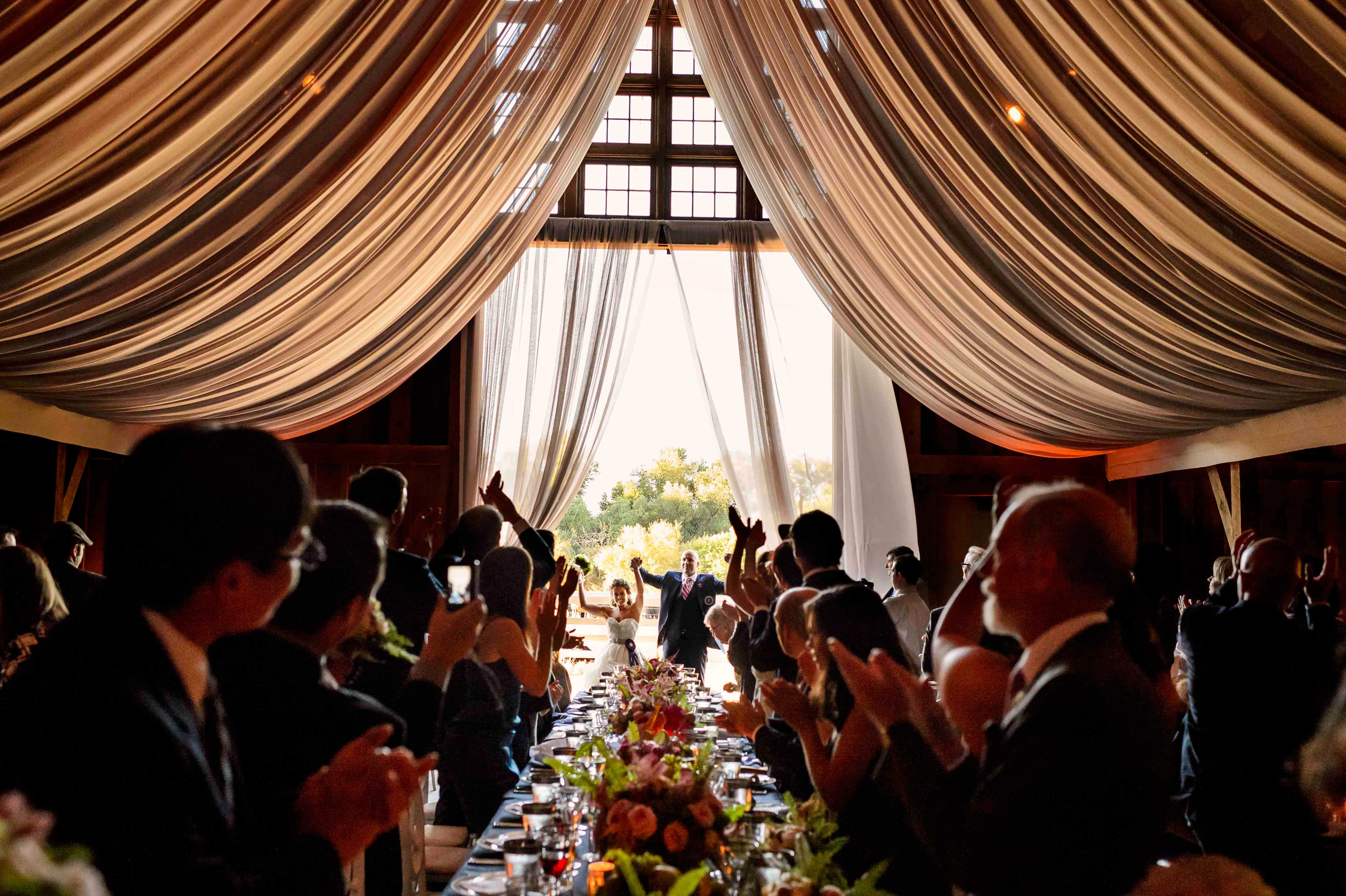 Barn wedding reception bride and groom entrance