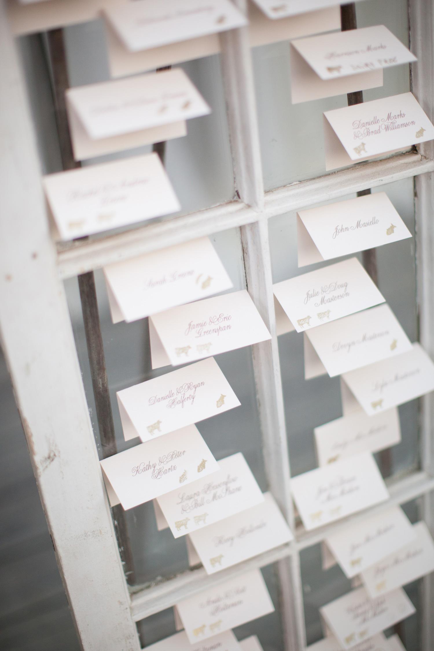 Escort cards taped to antique window or door