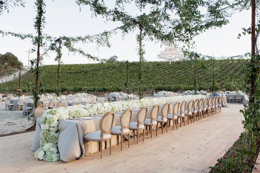 Green garlands on lighting at outdoor reception & Wedding Ideas: 8 Ways to Use Greenery in Decorations - Inside Weddings