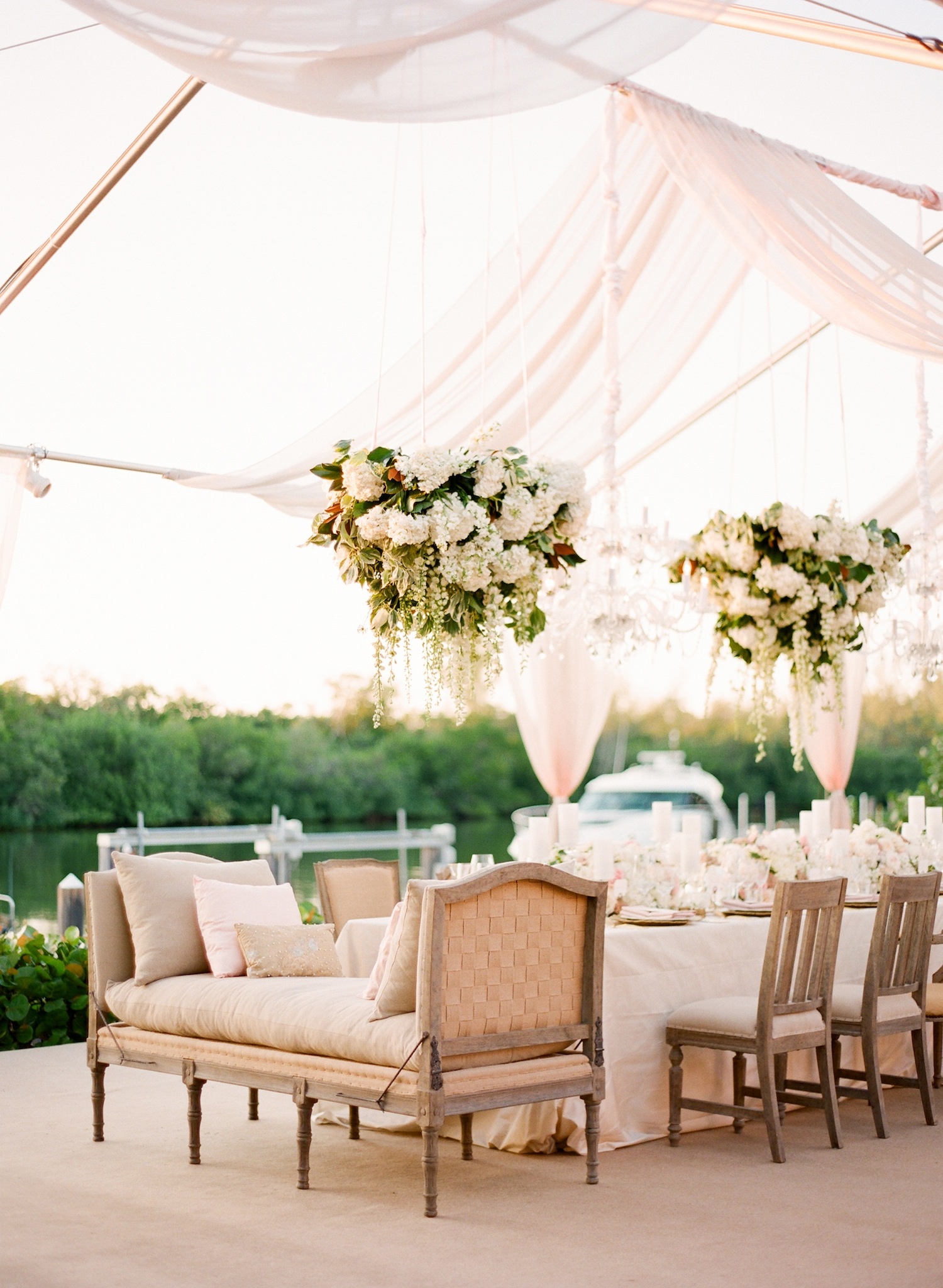 pink tent wedding with tan settee and chairs