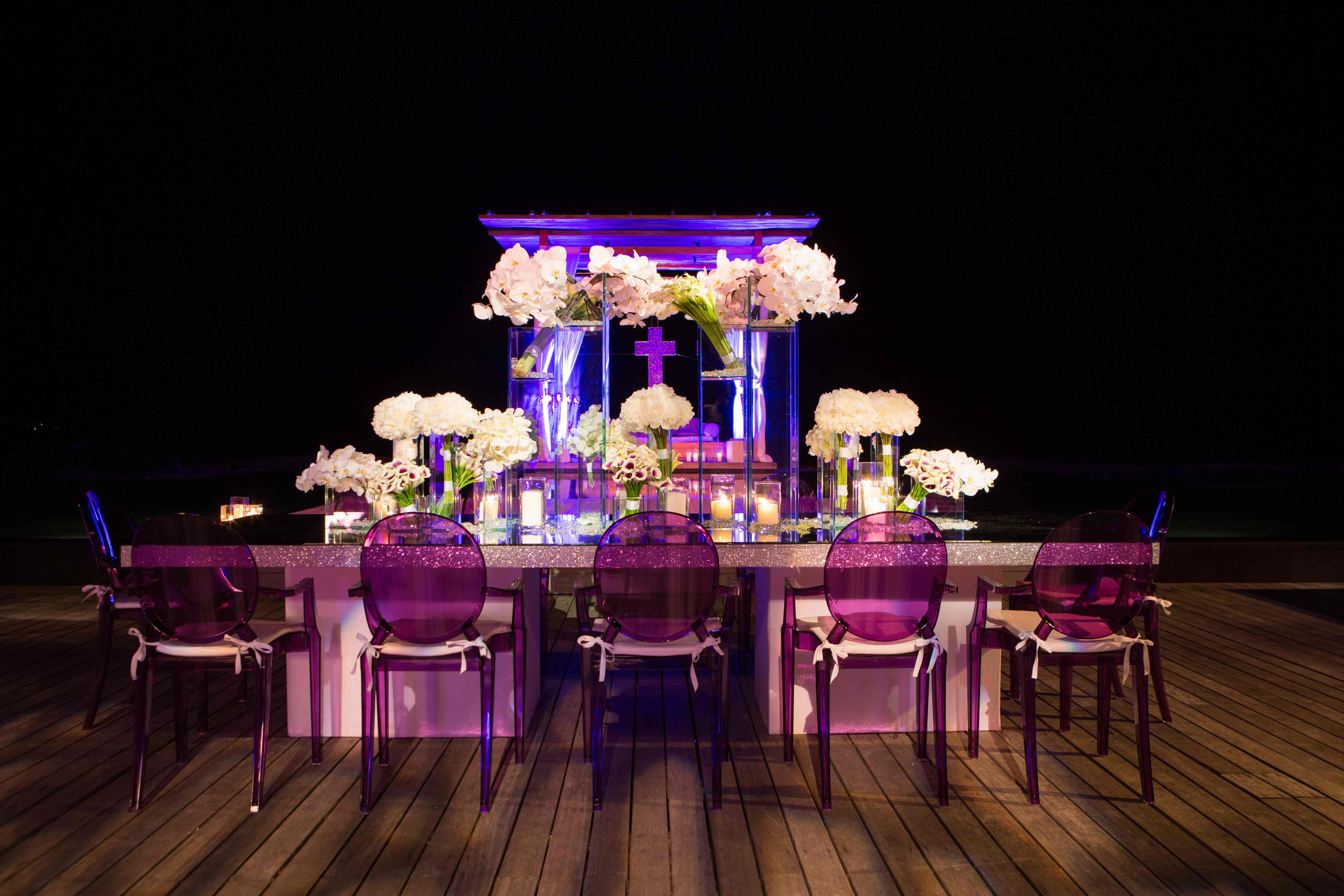 Destination wedding with purple Ghost chairs